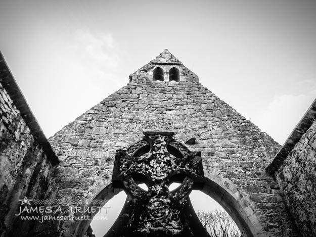 Celtic Cross inside Church Ruins in County Clare, Ireland