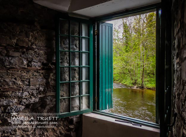 A large window opens onto the river from the first floor dining room at Thoor Ballylee.